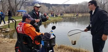 IMAGE of Veterans fishing during Winter Sports Clinic