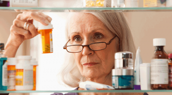 lady with prescription medication checking expiration dates