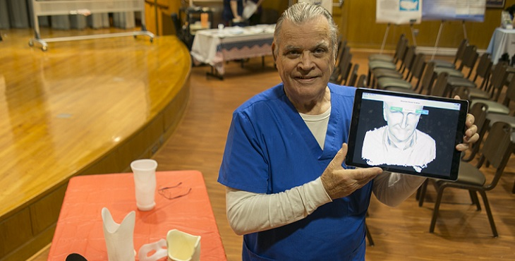 Picture of South Texas VA's senior prosthetist, Gordon Bosker showing his work on an ipad tablet
