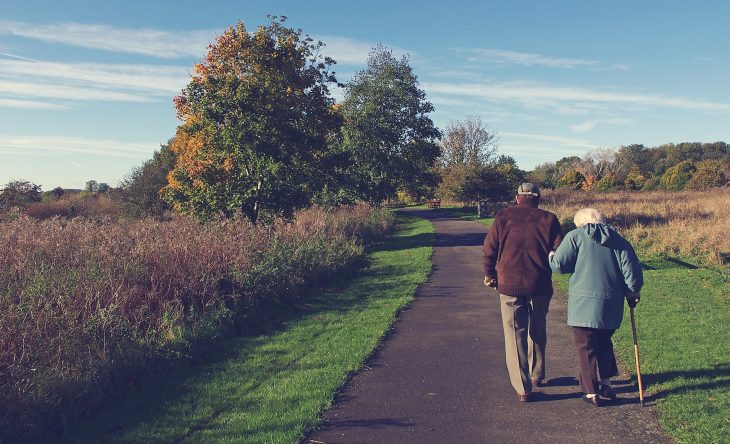 Stock image of older couple walking