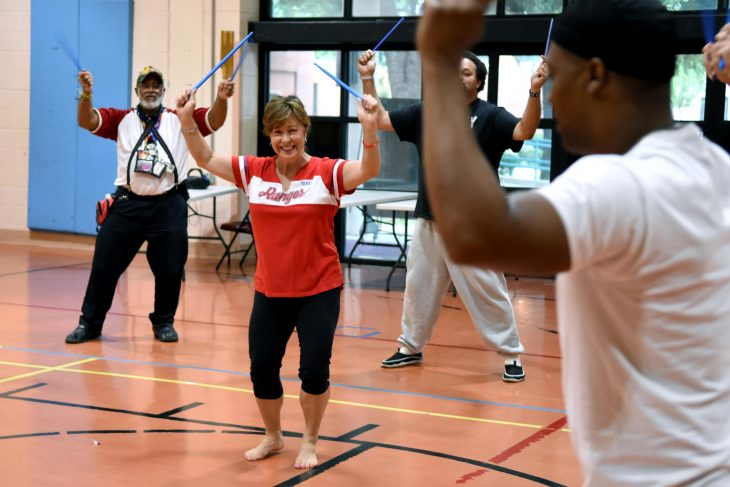 A recreation therapist leads a Drum Fit class for Veterans at the Dallas VA Medical Center.