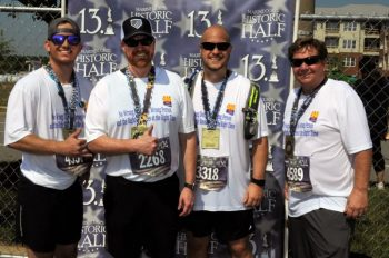 Sergeant C. Boen Olson, USMC Peter Reich, son and step son to 3 Veterans, Logan Gregory, military parent and Christopher Olson, Veteran and Veterans Experience Office employee, all ran together as the Be Connected team for the Marine Corps Historic Half Marathon in May.