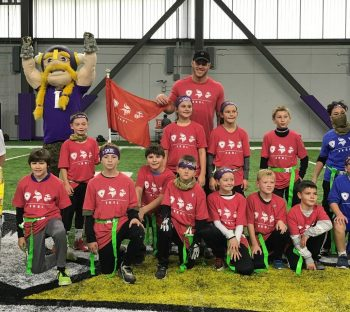 Minnesota Vikings Tight End Kyle Rudolph with a group of UHL Military Kids
