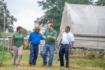 Metro Atlanta Urban Farm CEO Bobby Wilson talks with NRCS District Conservationist Shemekia Mosley, NRCS State Public Affairs Specialist Chris Groskreutz and FSA Beginning Farmer Regional Coordinator Rodney Brooks about future opportunities his farm. USDA photo by Preston Keres.