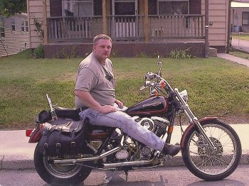 Rodney, with 16 years military service, on his Harley in 2000.