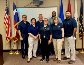 San Antonio Vet Center staff get together for a photo during their 40th Anniversary open house.