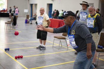Willis Williams competes in the NVGAG boccia event.