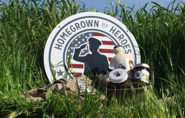 homegrown by heroes logo in field with products