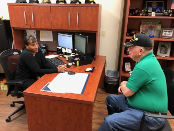 Judith Foster, a social worker with the Dublin VA, talks with a Veteran. Judith was awarded the Salute to Service Award from the Code of Support Foundation.
