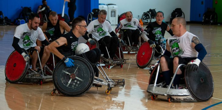 Noah Currier plays wheelchair basketball with fellow Veterans