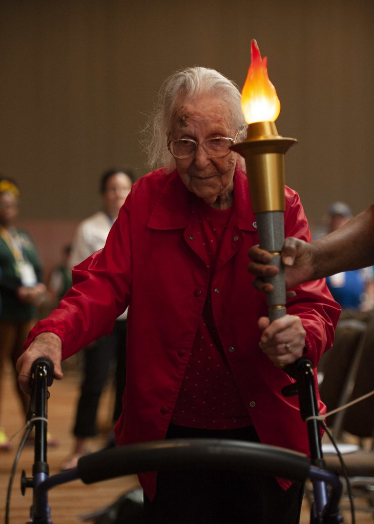 Wilma Gregory holds the games' torch