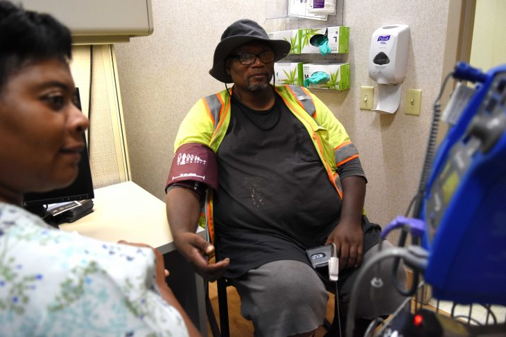 Veteran at Dallas' Bravo Clinic getting his vitals checked thanks to after-hours appointment times.