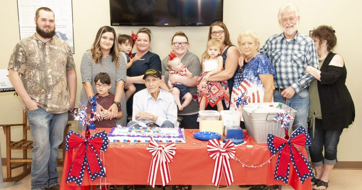 Family photo of Mr. Hunnicutt and his relatives who attended his 102nd birthday celebration