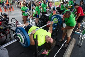 Wheelchair athlete power lifts at Wheelchair Games.
