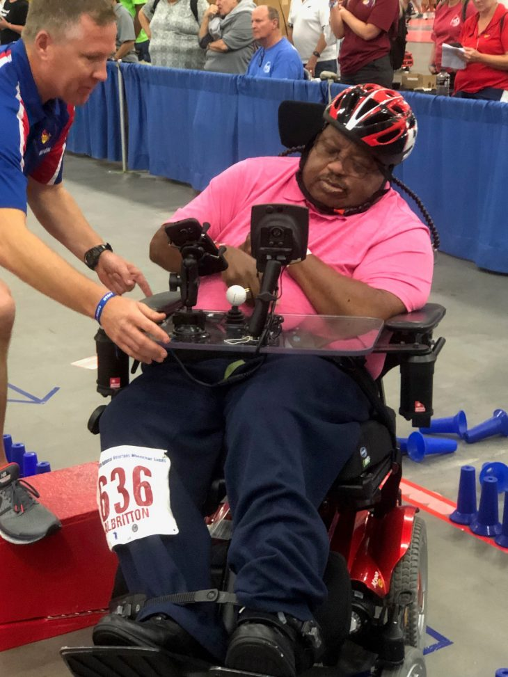 Ulysses navigating his way through the challenging wheelchair slalom course.