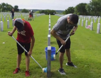 Volunteers cleaning headstone