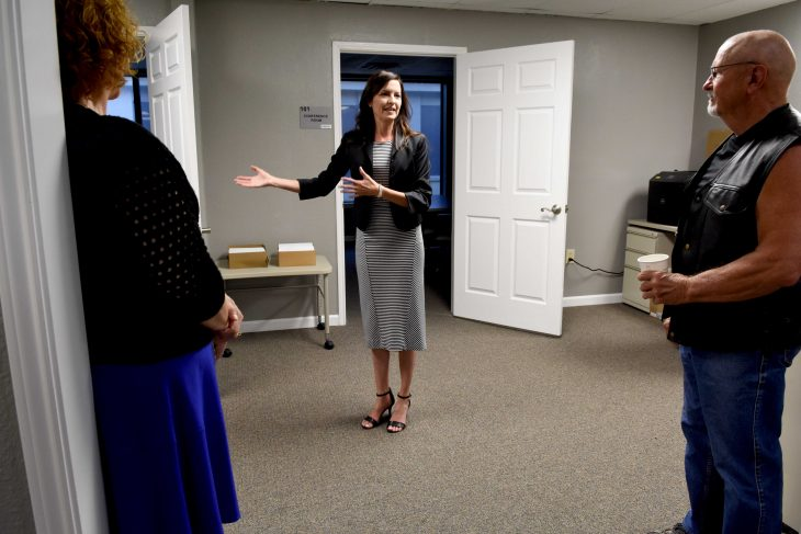 Dr. Jennifer Adams, VA North Texas psychologist, shows a room during the grand opening.