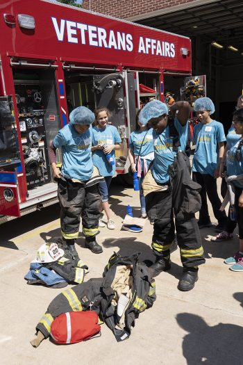 Middle School students learn about fire service and equipment at sHaPe camp.