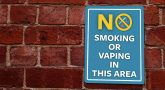 No Smoking sign on brick wall