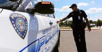 VA Police Officer opens door to his patrol vehicle