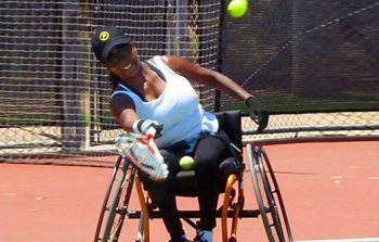 Twila Adams plays tennis.