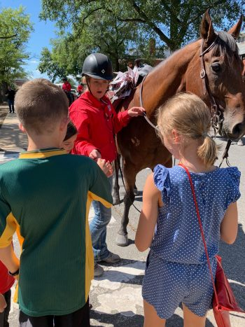 Children on Joint Base Myer-Henderson Hall talk to a BraveHearts rider.