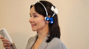 Woman wearing a light-emitting diode therapy headset.