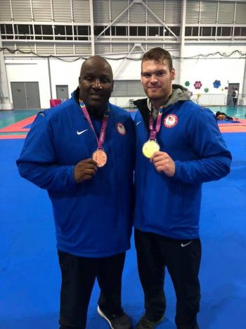 Johnny Birch and Evan Medell pose with medals