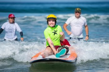 Olivia Nord surfs at the Summer Sports Clinic in San Diego.