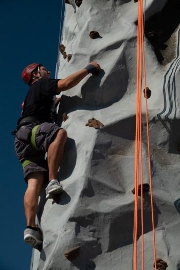 Veteran climbs rock wall