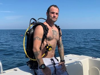 Shawn Campbell scuba dives for therapeutic treatment.