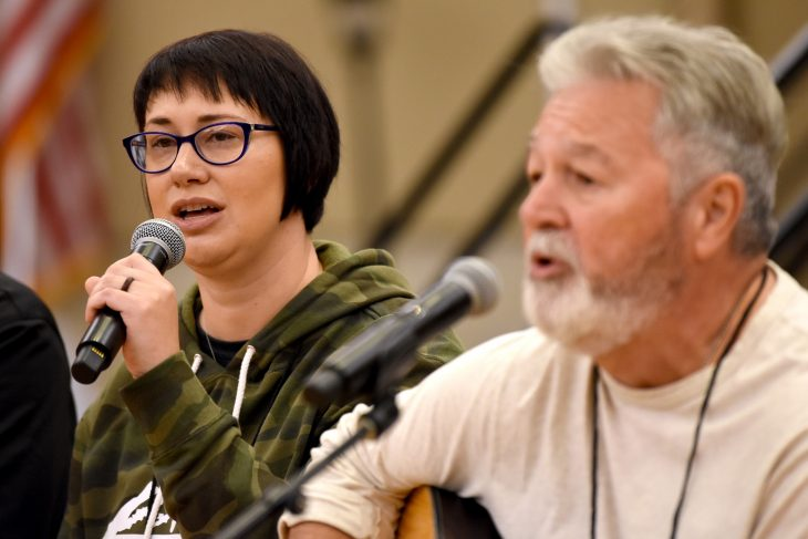 veteran singing next to her dad who is also a veteran