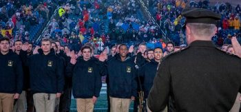 Army Chief of Staff Gen. James C. McConville swears in enlistees at the Nov. 24 Salute to Service game.