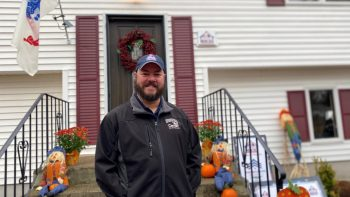 Army Veteran and Vet Center outreach technician Craig Hall in front of his newly renovated home in Glastonbury, Connecticut.