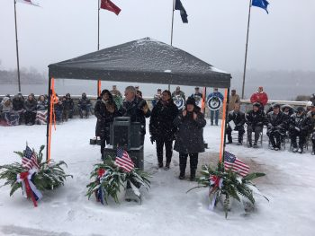 Speakers brave the snow during the Great Lakes National Cemetery event Nov. 11, 2019.