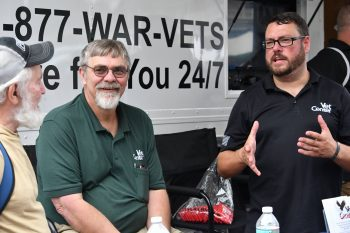 Craig Hall speaks to a Veteran during an outreach event.