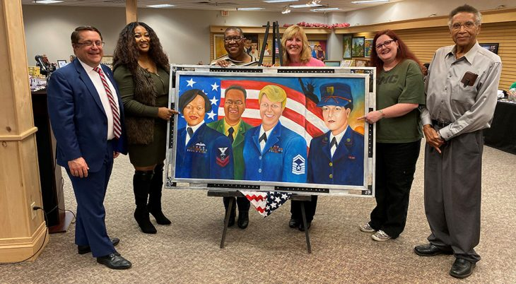 Six people display a large painting