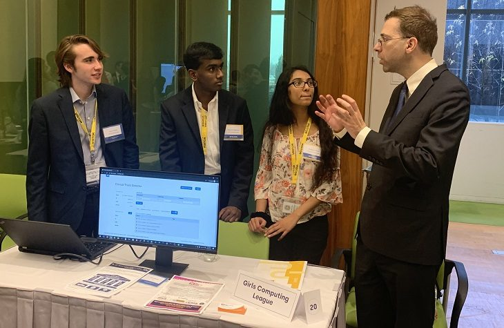 "IMAGE: Dr. Gil Alterovitz, Director, National Artificial Intelligence Institute, Department of Veterans Affairs, (right) with members of the Girls Computing League discuss the Clinical Trial Selector project at last week's ""demo day"" at the U.S. Census Bureau, Department of Commerce."