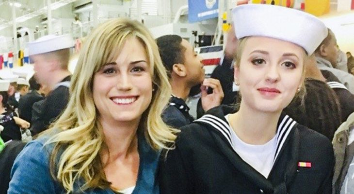 A woman and her in-uniform Navy daughter