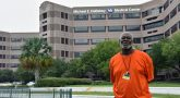 Lonnie Conerly stands in front of a VA hospital, where he traveled his road to recovery