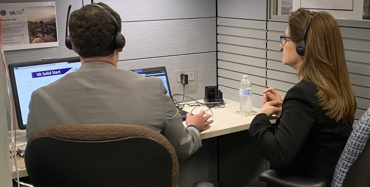 IMAGE: Two VA representatives on headsets talking to a transitioning service member or Veteran