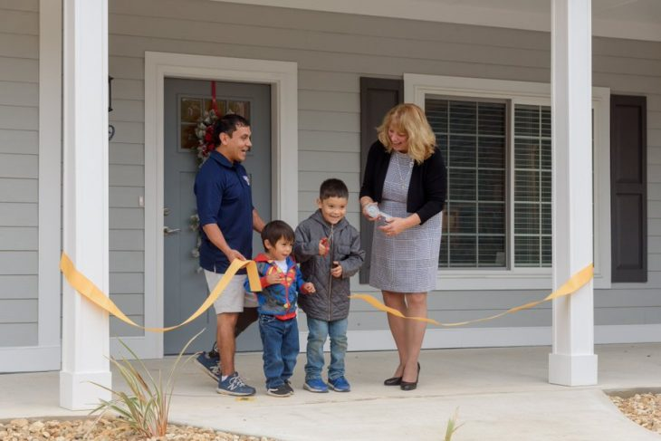 Vincente Ramirez and his sons at the ribbon cutting ceremony where his family was given a new, adapted home courtesy of the non-profit Homes For Our Troops.