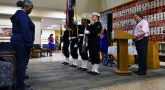 Chaplain speaks as color guard presents the flags