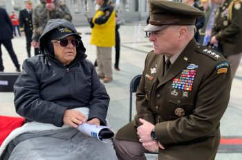 World War II Army Air Forces Veteran Constantine Rizopoulos, 91, talks to Army Gen. Mark Milley, chairman of the Joint Chiefs of Staff, at the Battle of Iwo Jima 75th Anniversary Commemoration Feb. 19 at the National World War II Memorial in Washington, D.C.