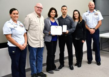 Family members receive Arturo Antonsanti's Purple Heart Medal Feb. 4.