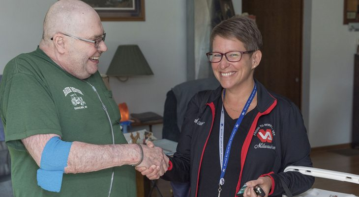 Marine veteran Kenneth Schmitt and RN Farrah Mosely during a home-based primary care visit in Elkhorn, Wisconsin.