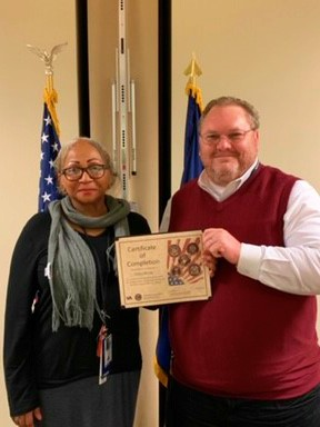 Janice receives her graduation certificate from Martinsburg VA Medical Center Interim Director Kenneth Allensworth