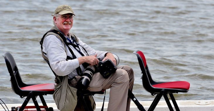 man in boat with cameras