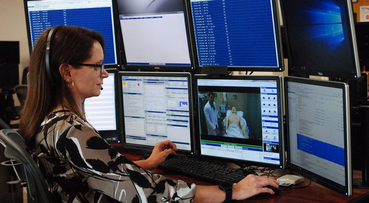 Doctor in front of computer screens for telehealth appointments