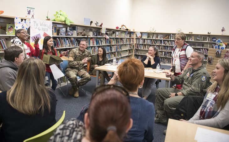 military kids gather in a classroom